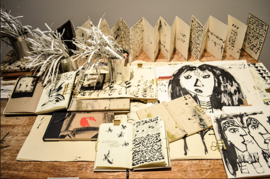 """Bouthayna Al-Muftah's """"The Golden Past"""" (2017), a mixed media work that uses books and tin cans to depict tradition."""