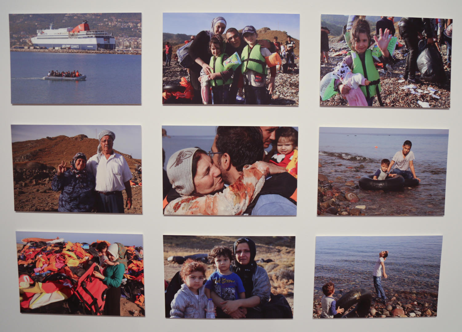 This+display+features+photographs+of+Syrian+families+as+they+arrive+on+the+shore+of+Lesvos.%0A