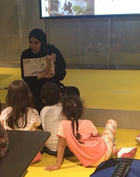 Faten+Azzam+reading+to+a+group+of+children+at+the+International+Literacy+Day+celebrations+at+Qatar+National+Library.+Photo+by+Fareehan+Moustafa.