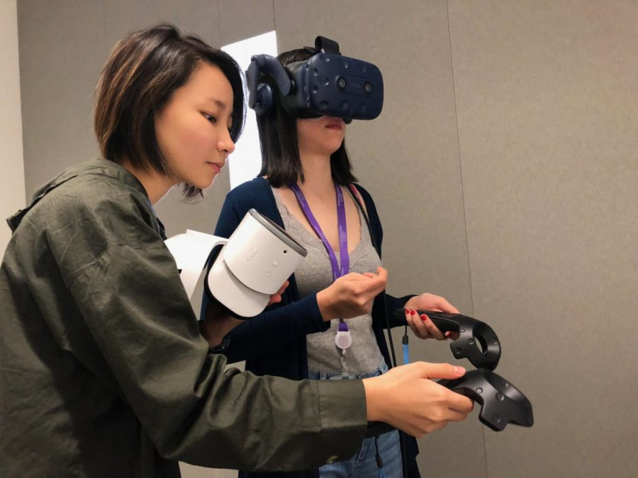 Students using the HTC Vive, which operates with two infra-red cameras that will map out a safe zone so students can move safely in their virtual realities. Photo by Ayah Awrtani.