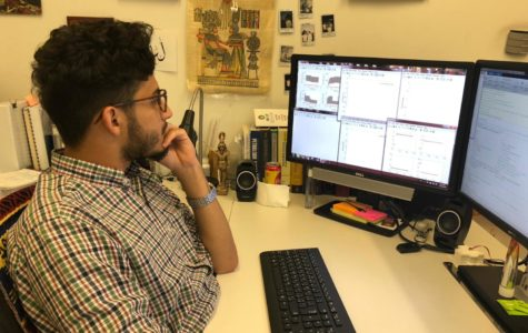 Osama Desouky, a graduate student at TAMU-Q, working at his office. Photo by Ayah Awrtani.