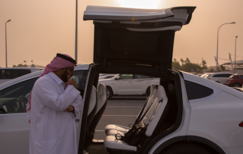 Abdullah Al Kuwari with his electric car, an imported Tesla Model X. Photo: Saad Ejaz.