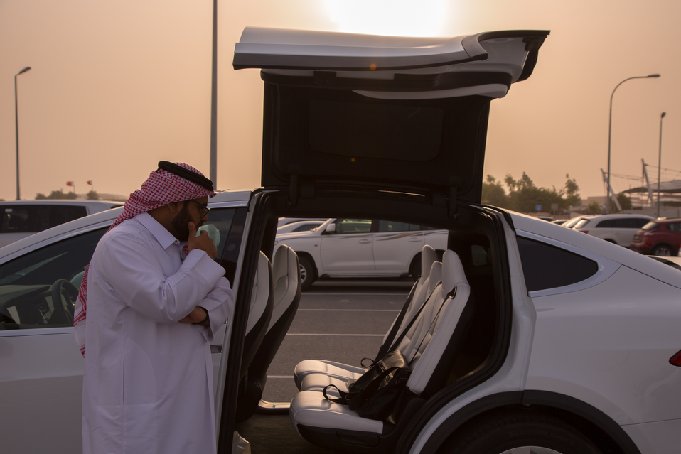 Abdullah Al Kuwari with his electric car, an imported Tesla Model X. Photo: Saad Ejaz.