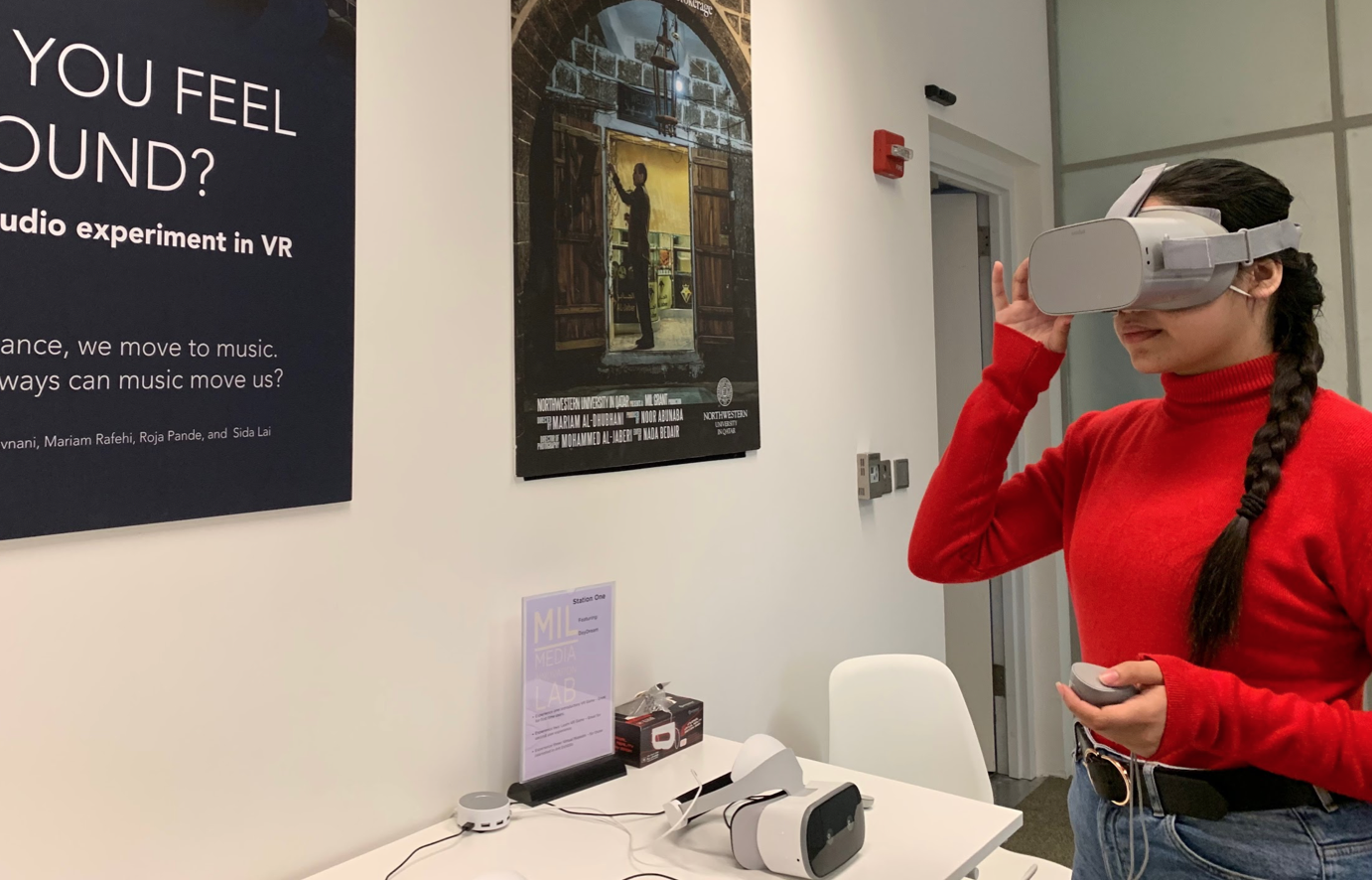 A student using the virtual reality headset in the Media Innovation Lab, Northwestern University in Qatar