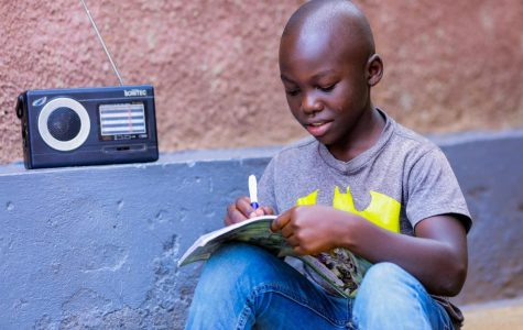 Igihozo Kevin, 11, studies at home due to coronavirus-related school closures in Rwanda, listening to his Primary 5 lessons on the radio every day. (Photo/ UNICEF)